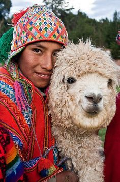 Teen boy Cuzco, Peru with his pet Alpaca. Alpacas typically serve the purpose of providing alpaca wool for weaving cloth for Peruvian families, and some will carry packs. But clearly, this boy sees his Alpaca as a beloved friend. We Are The World, People Around The World, Around The Worlds, Cultures Du Monde, World Cultures, Machu Picchu, Anthropologie, Foto Picture, Cusco Peru