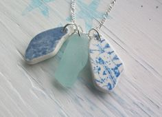 Drill holes in sea glass, add O-rings, hang on silver chain.