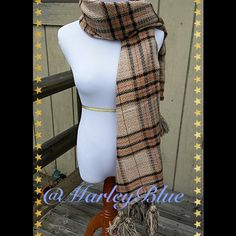 SALEIncredible Oversized Plaid Fall/Winter Scarf Oversized shawl or blanket style plaid scarf. Design made up of tan and white with black running throughout, as well as berry colored pinstripes . Scarf has large tassels hanging from ends. Scarf measures approximately 63 inches long (not including tassels) and 26 inches wide. 20% wool 80% acrylic. Will keep you warm and stylish. Many different looks with this scarf. Scarf is very neutral and would pair well with my beige or black knit cap or…