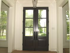 This 3-light Spanish Cedar front door has been stained a dark walnut color to provide a contrast against the white mouldings and trim.