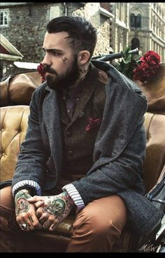 layered luxe: thick wollen coat with hand tattoos and moustache