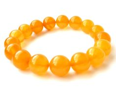 Baltic Amber bracelet made out of dark butterscotch semi-transparent beads 12 mm in diameter. Natural untreated beads, polished. Each bead is carved out of one piece of amber. 12 mm 14.7 gram