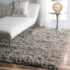 Rest your feet in the gentle wool pile of this Alexa Flokati shagrug. The design features a thick nap of New Zealand wool in a solidcolor for contemporary style that adds luxury to everyday moments.Av