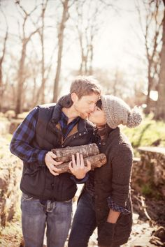 (Cozy winter themed engagement session) Love her hat and I'm a sucker for flannel on guys! :D