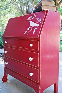 Red secretary desk with bird