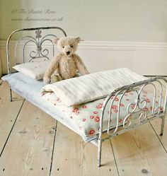 Beautiful antique dolls bed, we made an eiderdown and pillow for it...