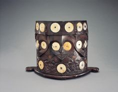 Photograph; Baby Carrier (ba')  Circa; Mid 20th Century A.B. Cultural group; Bahau Dayak peoples Country; East Kalimantan (Borneo), Indonesia  Materials: wood, shells, fibre, and felt Measurement; h. 31.20 cm., w. 44.00 cm., depth. 15.00 cm. Gifted; The Jerome L. Joss Collection Housed; Fowler Museum At UCLA Museum Purchase; X85.1076 COPYRIGHT © Fowler Museum