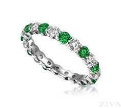 Nestled into a prong setting, the emeralds in this diamond and emerald eternity band help emphasize the confidence and loyalty that are shared between two lovers headed for eternal bliss. Emerald Eternity Band, Emerald Band, Emerald Jewelry, Eternity Bands, Sapphire Diamond, Diamond Bands, Diamond Wedding Bands, Diamond Jewelry, Diamond Cuts