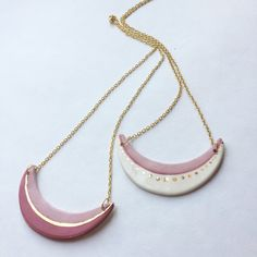 This listing is for hand made ceramic and 22k gold pendant on your choice of chain. This minimalist modern design has a striking contrast in textures from the matte rose glaze, shiny glasslike glaze and real 22k gold fired on for permanence! At nearly 3 long and 2 tall shining with gold,