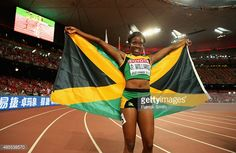 Danielle Williams of Jamaica celebrates after crossing the finish line to win gold in the Women's 100 metres hurdles final during day seven of the 15th IAAF World Athletics Championships Beijing 2015 at Beijing National Stadium on August 28, 2015 in Beijing, China.