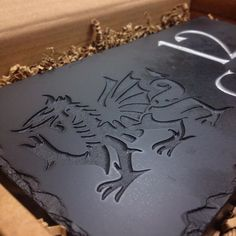 Another Welsh slate house sign completed for a customer - this one proudly displays a deep engraved dragon. If you're re-vamping your house front, make sure you take a look at our website for a range of different signage options...