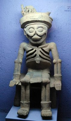 The God of Death.    This ceramic figure of the God of Death comes from ancient Veracruz Mexico. Tamayo museum collection of Oaxaca Mexico.
