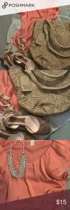 Dressbarn tank top Soft Satin 100% polyester peach colored tank top. Very beautiful and comfortable. Hardly warrants so it's in excellent condition. The Vera Wang purse is listed in my closet individually along with the boutique wedges. Dress Barn Tops Tank Tops