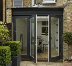 Cleaner looking bi-fold with lantern II.by the way I think lime foliage and off black matt works a treat Glass Extension, Extension Ideas, Kitchen Ideas, Kitchen Board, Roof Lantern, External Doors, House Extensions, Back Gardens, Bay Window