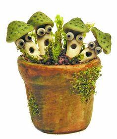 Adorable polymer clay mushrooms by Kiva Atkinson of Kiva's Miniatures blog.