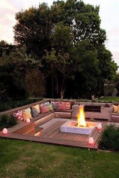 Outdoor sunken sitting area with fire pit.