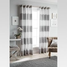 The modern and fresh Threshold Bold Stripe Curtain Panel is sure to become your newest obsession. This gorgeous panel features top grommets for a beautifully draped curtain and will add style and sophistication to any space. Grey Striped Curtains, Bold Curtains, Target Curtains, Curtains For Grey Walls, Living Room Decor Curtains, Panel Curtains, Curtain Panels, Navy Walls, Elegant Curtains