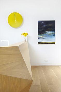 reception - same wood for floor and desk