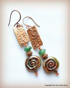 Double spirals of artisan copper and raku lampwork.  By Two Trees Studio.