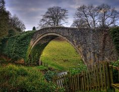 The Brig o' Doon is a late medieval bridge used as the setting for the final verse of the Robert Burns's poem Tam o' Shanter. The bridge is located near Alloway in South Ayrshire & crosses the River Doon. It was rebuilt in the 18th century. The bridge features on the 2007 series of £5 notes issued by the Bank of Scotland, alongside the statue to Robert Burns which is located in Dumfries.