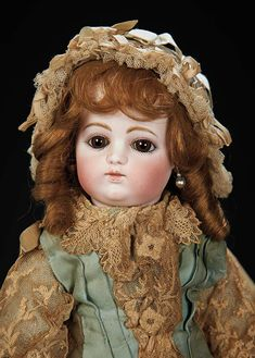 Marks: F 6 G. Comments: Gaultier,circa 1880,early model with block letter signature. Value Points: most endearing expression,very deep eyes,original early body and body finish,and wearing superb original couturier dress,with undergarments,ruffled lace bonnet,socks,and shoes.