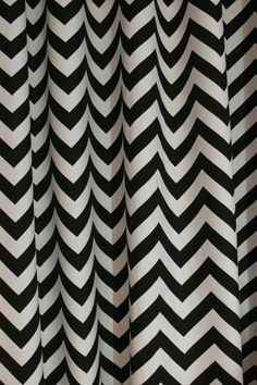 "Since you liked the Chevron wallpaper from the room featured on Tastemaker, I thought we could incorporate some of the bold pattern with the curtains.  - A pair of Custom Drapes Zigzag Black and White 50"" wide X up to 84"" Long"