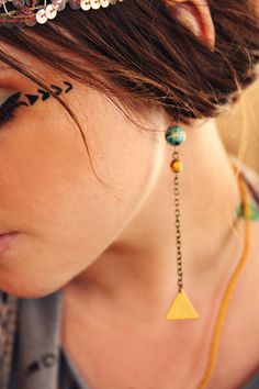 adelaine. a pair of teal and gold geometric earrings.