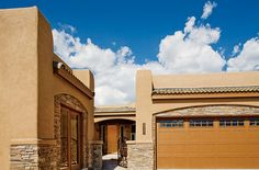 Split garage Southwestern home with courtyard in La Cuentista on the Westside of Albuquerque. Southwestern Home, Custom Builders, 3 Car Garage, Courtyard House, Model Homes, Custom Homes, Sweet Home, Exterior, Mansions