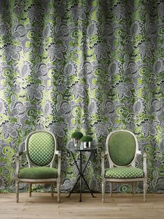 Yolanta Fabric Inspired by mosaics from a Byzantine palace, this captivating woven fabric features a tree of life design in blavk and off-white on a contrasting apple green ground with diagonal line detailing.