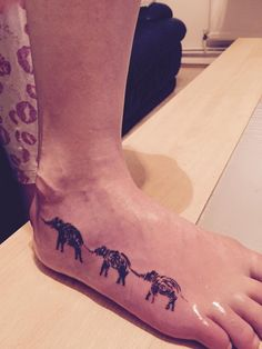 My new tattoo!! ❤️ it. A string of African elephants cut from my husbands thumb print