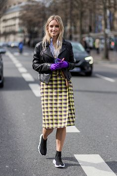 Charlotte Groeneveld wearing a checked coat cropped leather jacket outside Ellery on March 7 2017 in Paris France