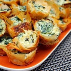 Spanakopita Bites: A perfect bite of spinach and cheeses nestled in flaky, buttery phyllo...