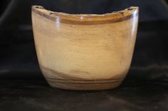 This bowl is made form Ash picked from the Maine woods. It features a natural edge and silky smooth finish. It stands 4 3/4 inches diameter and stands 4 1/2 inches tall.
