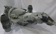 Adrian Drake spent 475 hours over the course of 21 months to build this painstakingly accurate model of Firefly's Serenity entirely out of Lego bricks. The result is this 135-pound, seven-foot long, 70,000-brick beauty that looks especially shiny paired with its minifig crew.