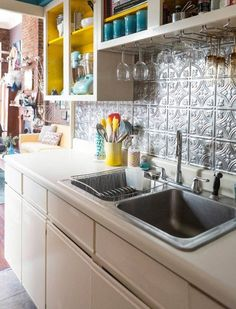The Ultimate Guide to Backsplashes for the kitchen. Tin tile or mosaic tile are my top choices.