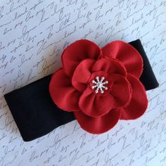 Red fabric flower headband with snowflake by Yuliyasboutique, $7.00
