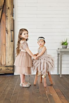 2 girls styling Tutu Du Monde fancy dresses for kids from Rainey's Closet.