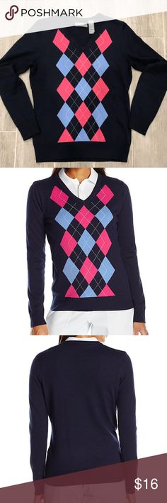 Callaway Women's Golf Performance Argyle Sweater Ladies Callaway golf sweater. Color is dark blue with pink and light blue argyle design. Tag removed on lower inside seam. Fitted design. Material: 70% Polyester / 30% Wool Callaway Sweaters V-Necks