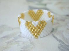 Peyote Ring Hearts in White and Gold Seed Bead Ring Beaded Band Handmade Love Romantic. via Etsy.
