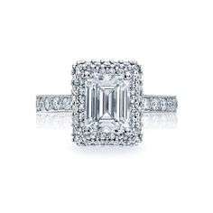 Tacori emerald cut. The cut and the way the stones are laid around it are very interesting
