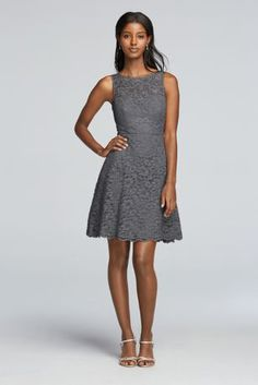 The illusion lace neckline adds a cool cutout effect to this short lace bridesmaid dress.   High illusion sweetheart neckline.  Skirt sits above the knee with scalloped hemline.  Fully lined. Zipper Back. Imported polyester. Dry clean only.  To protect your dress, try our Non Woven Garment Bag.