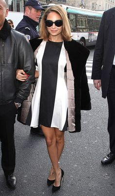 Nicole Richie in a black and white mini dress with large solid panels.