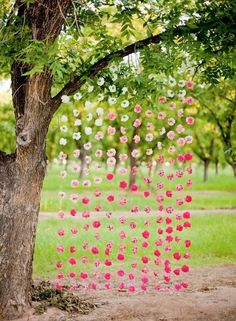 A color fade of flower blossoms strung on fishing wire makes for a great photo backdrop and helps integrate your color theme into the Cocktail and Ceremony Lawns. | Signature Color | Color Face | Flower Blossoms | Floral Design | Photo via: ripple-d.tumblr.com