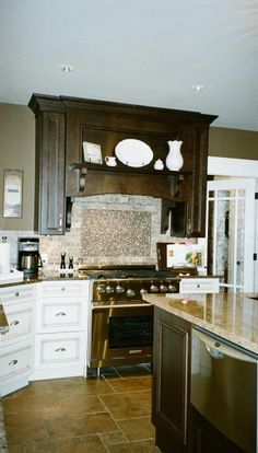 Stunning cabinetry done by Generation Cabinets.  Trish Becher Interior Design: kitchen, island, gorgeous, stove