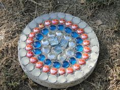 "8"" Orange and Turquoise Garden Stone Made from Glass Stones and Concrete. $21.99, via Etsy."