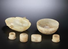 A group of small pale brown and grey jade vessels, Western Han Dynasty