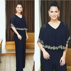 When Jumpsuit Meets The Cape... Rochelle Rao is killing it in a Namarata Joshipura outfit again. This time dressed a black cape jumpsuit with top knot bun and statement earrings, she looks pure glam. We love it when different trends meet to create something more interesting... Get the look at https://www.estrolo.com/whatstrending/jumpsuit-meets-cape/