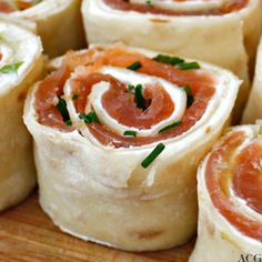 Smoked salmon, snofrisk norwegian cheese, scallions and chives rolled up