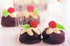 "Mini Christmas puddings - chocolate coated marshmallow cookie, white chocolate, ""cherry candy"", and spearment leaf"