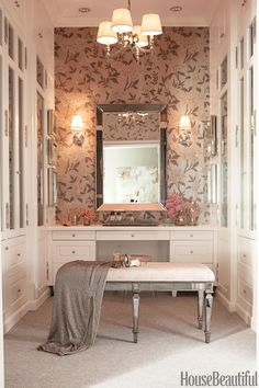 In a Los Angeles house designed by Mary McDonald, Schumacher's Whitney Floral wallpaper and a Venetian mirror give movie-star glamour to the dressing room. The bench was designed by McDonald. - HouseBeautiful.com